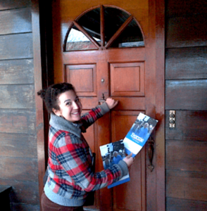 Woman knocking on door with flyers